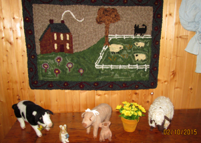 Hooked by Beverly Matthews from Ohio with current color variations in the kit. Beverly has also purchased some of my felted animals  that decorate the table below the rug.