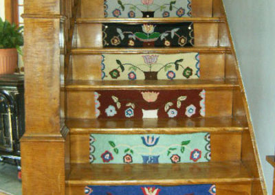 Stair Riser #3 hooked by Linda Ellis who is hooked the same pattern but different colors for each riser – looks great!